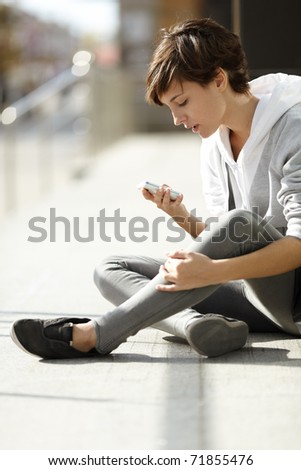 Girl With Cell-phone - stock photo