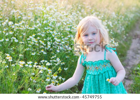 girl with chamomile - stock photo