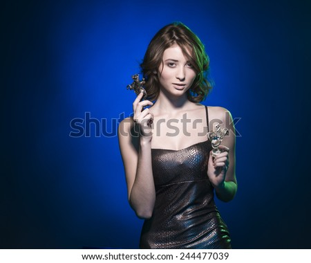 girl with chess pieces in the hands of - stock photo