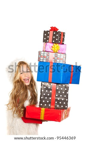 girl with christmas present gifts stacked on white background - stock photo