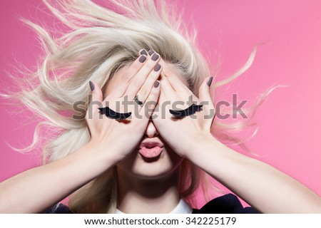 Girl with closed eyes painted on hands - stock photo