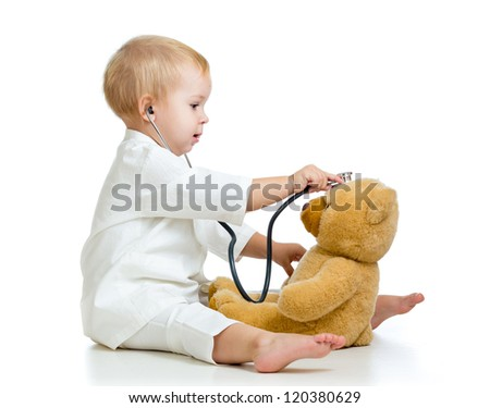 girl with clothes of doctor and teddy bear isolated on white - stock photo