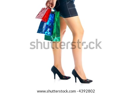 girl with colored handbags over white - stock photo