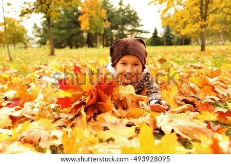 girl with colorful autumn leaves