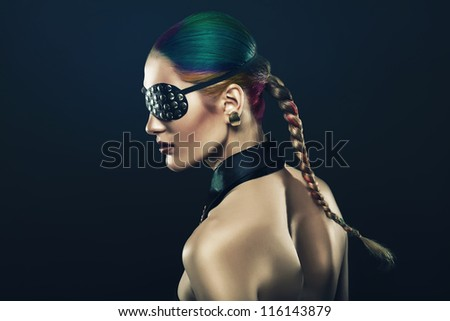 girl with coloured hair and eye-patch - stock photo