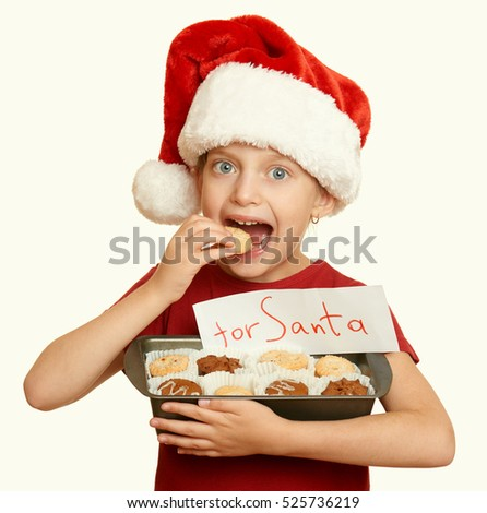 girl with cookies for santa, winter holiday christmas concept, yellow toned