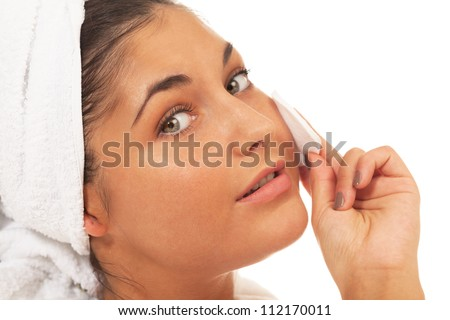 Girl with cotton pad on isolated white