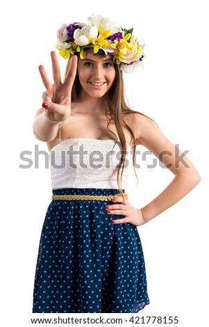 Girl with crown of flowers counting three