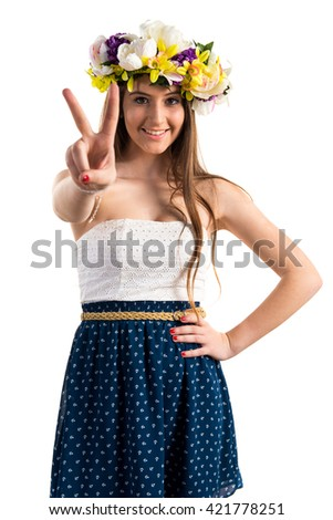Girl with crown of flowers counting two