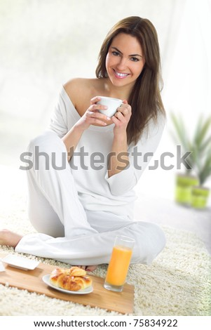 girl with cup of coffee - stock photo