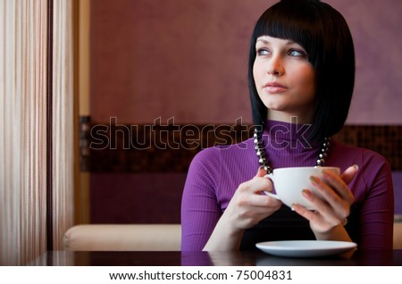 girl with cup of coffee in hands - stock photo