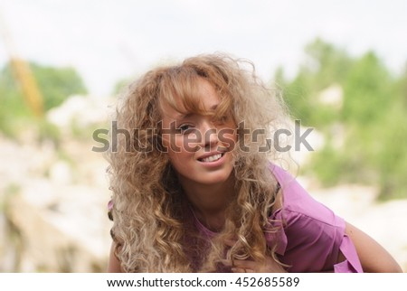 girl with curly red hair