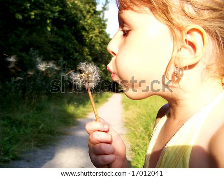 girl with dandelion - stock photo