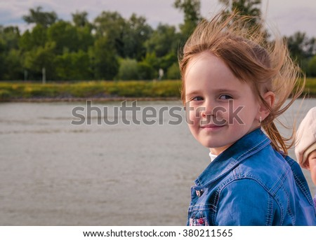 Girl with disheveled hair close-up.