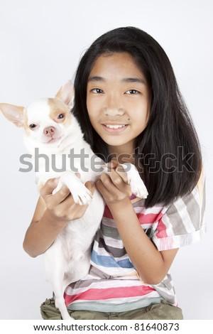 girl with dog, Asian girl holding brown chi hua hua dog. - stock photo
