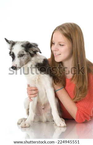 Girl with dog isolated on white