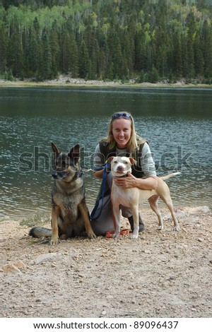 Girl with dogs - stock photo