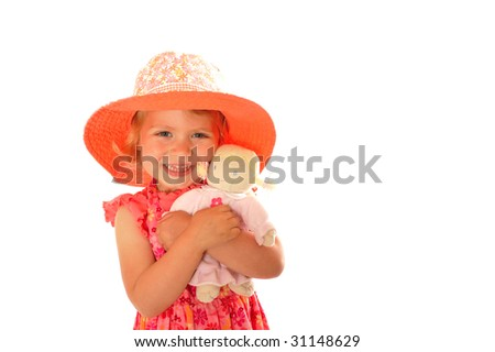Girl with Doll, Dress, and Hat - stock photo