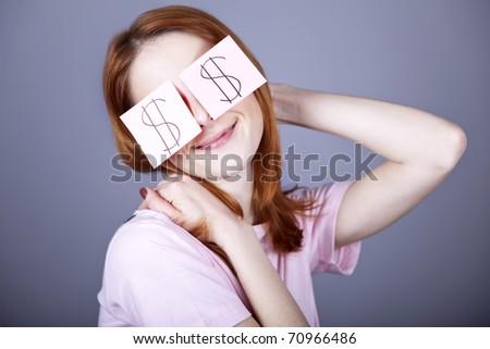 Girl with dollars symbol on eyes. - stock photo