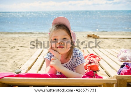 girl with dreamy face lying and relaxing of south beach  - stock photo