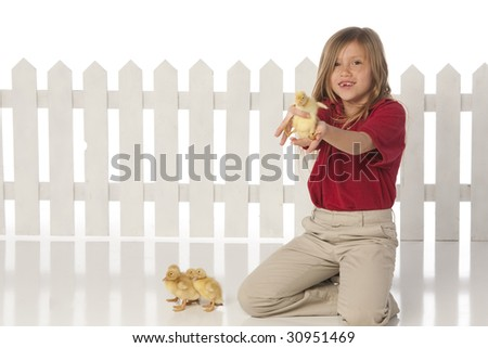 Girl with ducklings