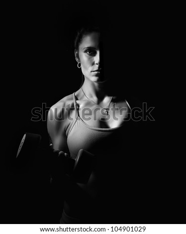 girl with dumbbells. black and white photo - stock photo