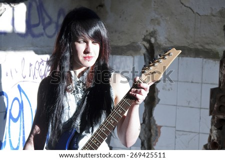 girl with electric guitar - stock photo