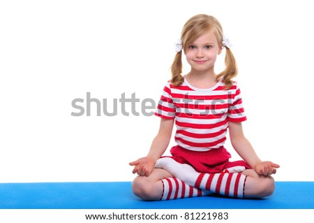 girl with eyes open practice yoga on blue rug - stock photo