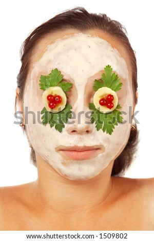 Girl with face pack colorful facial mask on her face isolated on white