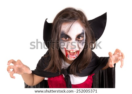 Girl with face-paint and Halloween vampire costume isolated in white - stock photo