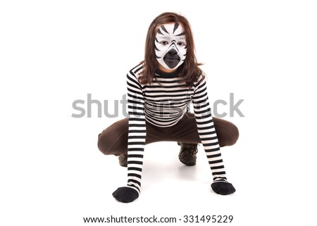 Girl with face-paint like a zebra isolated in white background - stock photo