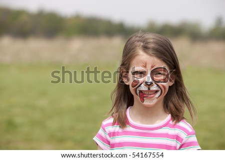 girl with face painted as a dog