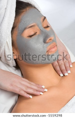 Girl with facial mask (eyes are closed)