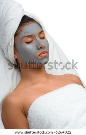 Girl with facial mask (eyes are closed) - stock photo