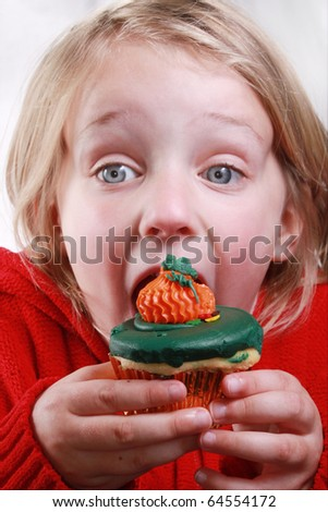 Girl with fall cupcake