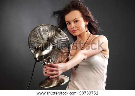 girl with fan - stock photo
