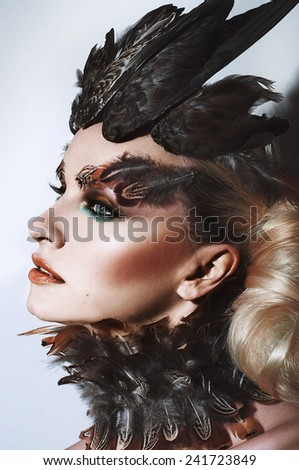 Girl with feather make up