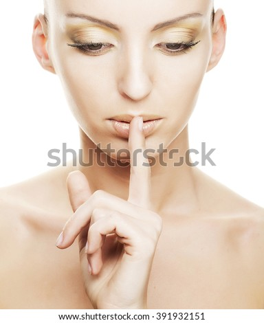 girl with finger over her mouth - stock photo