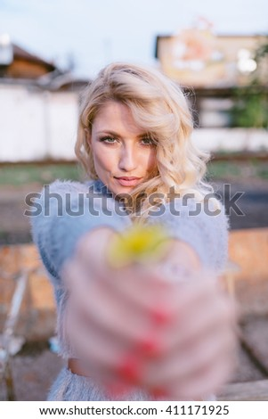 Girl with flower in her hand