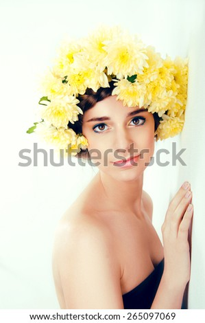 Girl with flower wreath. Caucasian woman with suntanned glowing skin and  brown hair close up - stock photo