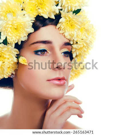 Girl with flower wreath. Caucasian woman with yellow chrysanthemum flowers suntanned glowing skin and  brown hair close up on white background - stock photo