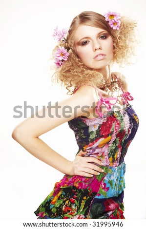 girl with flowers in beautiful dress on white background - stock photo