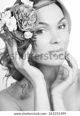 girl with flowers on a white background - stock photo