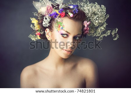 girl with flowers on her head - stock photo
