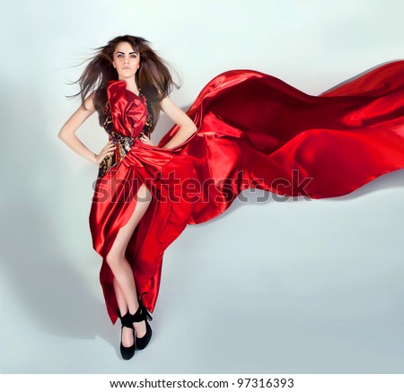 girl with flowing hair in the red dress - stock photo