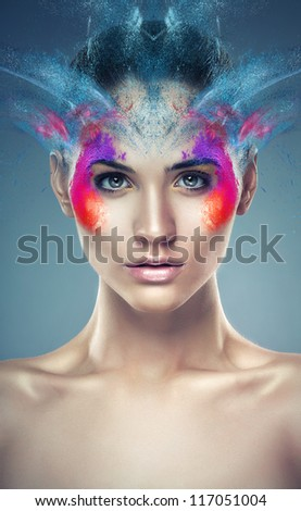 girl with flying powder above head