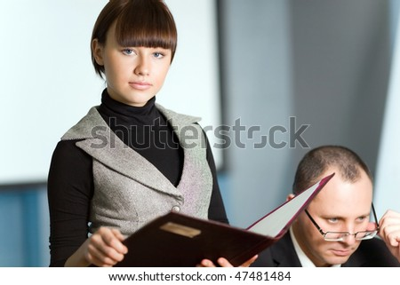 Girl with folder and men - stock photo