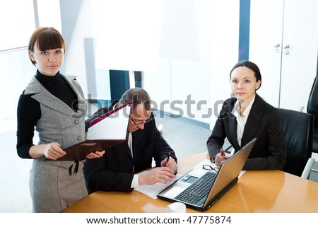 Girl with folder and women with men
