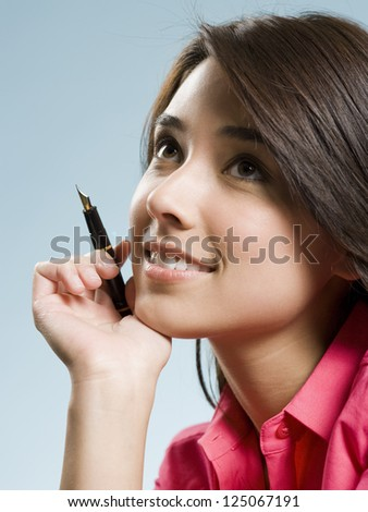 Girl with fountain pen smiling