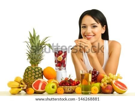 Girl with fresh fruits isolated on white - stock photo
